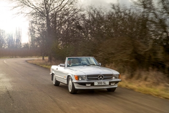 Side view of a white SL Shop Mercedes-Benz R107 300 SL hire car