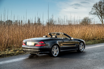 SL Shop Mercedes-Benz R230 SL500 LIMITED SPORT 5.5 Hire Car along a country road