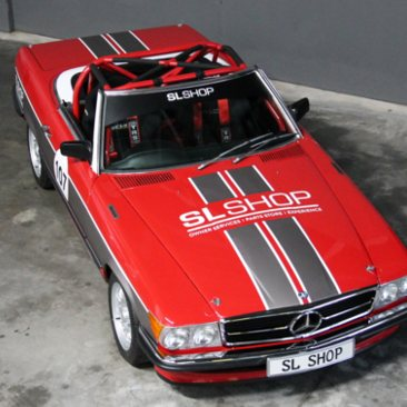 A red and black SL Shop Mercedes-Benz 107 500SL race car