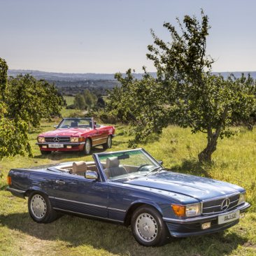2 SL Shop Mercedes-Benz R107's parked in the countryside
