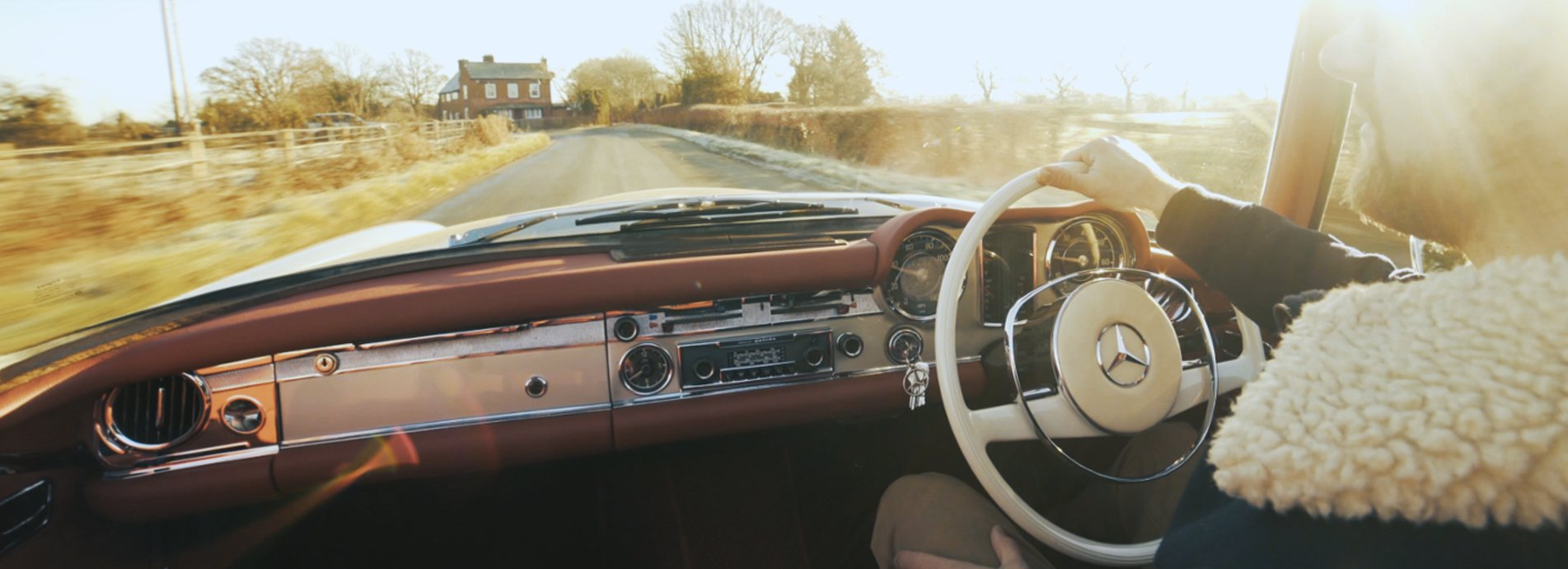 Interior of an SL Shop hire car shown whilst driving through the frosty countryside