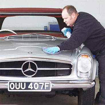 Man cleaning Mercedes-Benz Pagoda at The SL Shop