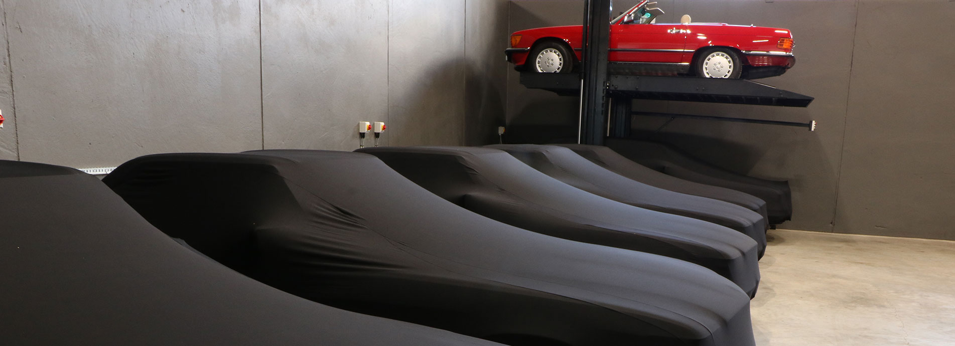 Fleet of classic Mercedes-Benz cars covered in The SL Shop storage unit