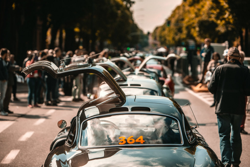 A procession of 300SL Gullwing's with their doors open