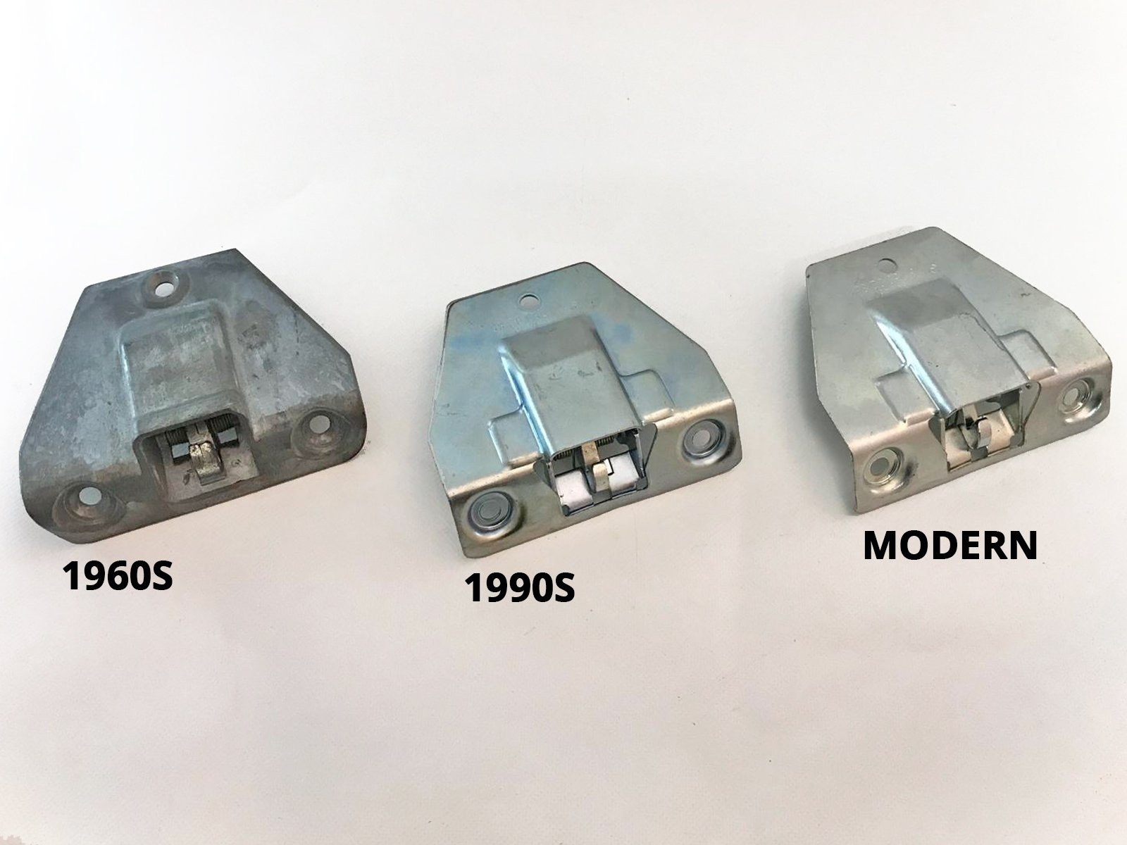 Three different generations of Mercedes parts - boot locks from the 60s, 90s and Millennium.