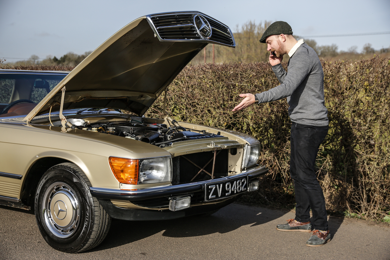 An SL owner stopped at the roadside inspecting the engine for problems following use of E10 Fuel.