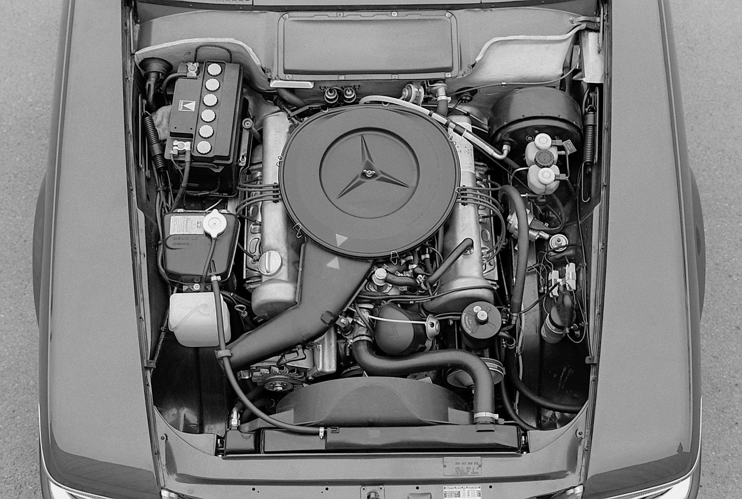 The signature V8 shown here in an early Mercedes R107 350 SL