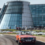Signal Red R107 SL driving past Mercedes-Benz World