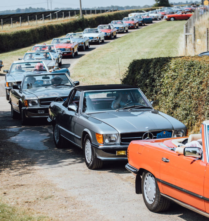Convoy of Convertible Mercedes models at SLSHOP's 50th anniversary event.